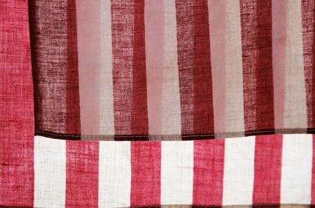 pledge of allegiance: backlit American flags showing the stripe details