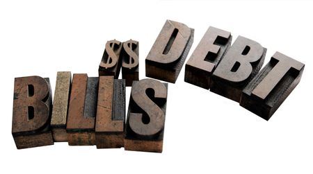 dollar signs: the words bills and debt with two dollar signs in wood type