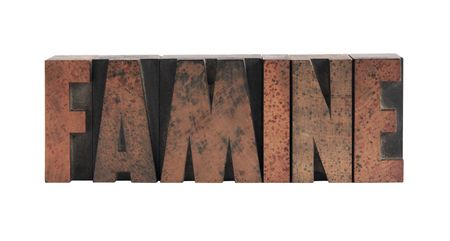 famine: the word famine in old, ink-stained wood type