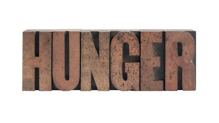 the word hunger in old, ink-stained wood type