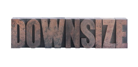 downsize: the word downsize in old ink-stained wood type