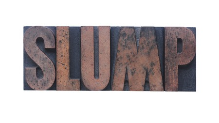 slump: the word slump in old ink-stained wood type