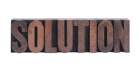 the word solution in old ink-stained wood type