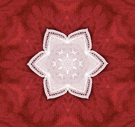 hexagonal lace star on red tapestry background