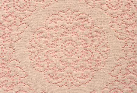 beige Spitze doily am nützlichsten für einen rosa Hintergrund