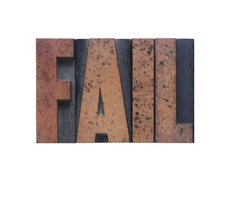 inadequate: the word fail in old ink-stained wood type  Stock Photo