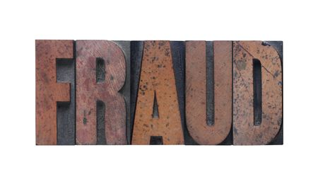 the word fraud in old ink-stained wood type