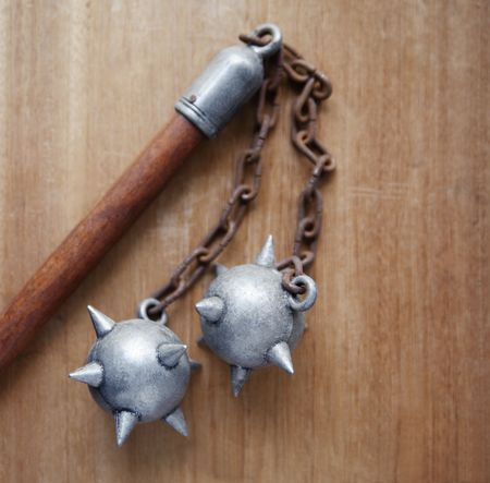 flail: double flail on wood background