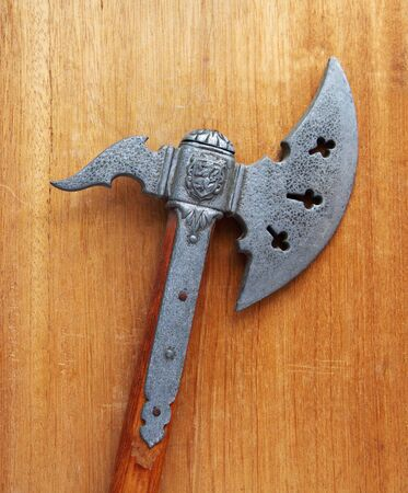 replica of an old battle axe with a wood handle