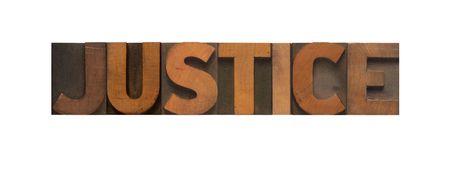 validez: la justicia de palabra en el antiguo tipo de madera Foto de archivo