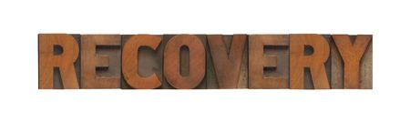 the word recovery in old wood type 版權商用圖片