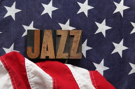 an old flag with the word jazz in old, ink-stained wood type photo