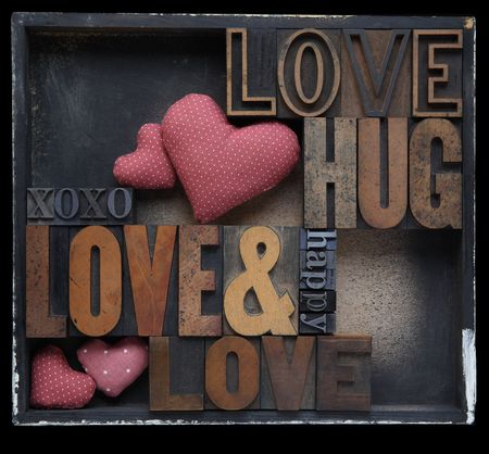 love and related words in wood and metal letterpress type with fabric hearts in a box photo