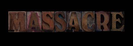 the word massacre in old letterpress wood type Reklamní fotografie