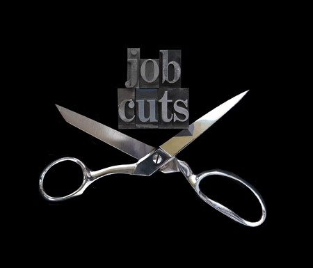 the words job cuts with a pair of scissors on black Stock Photo - 7372494