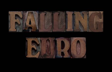 the words falling euro in old letterpress wood type Stock Photo - 7909346