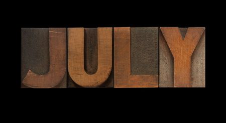 the word July in old letterpress wood type Stock Photo - 7909373