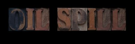 the words oil spill in old letterpress wood type Stock Photo - 7909362