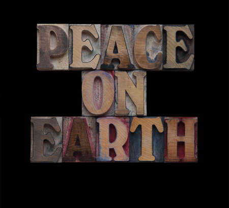 the words peace on earth isolated on black photo