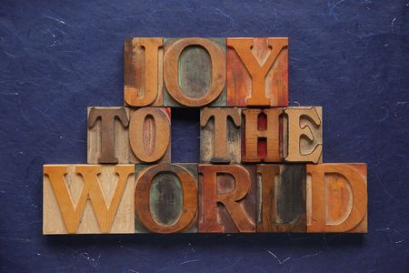 the words joy to the world in old wood type Stock Photo