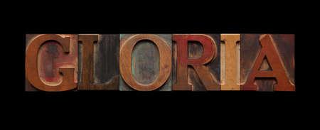 gloria: the word gloria in old wood type on black Stock Photo