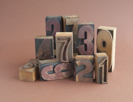 arrangement of wood type numbers on brown photo