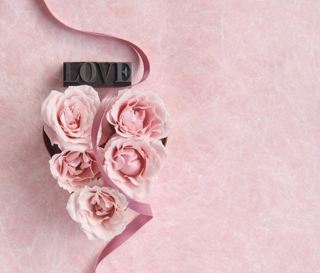 pink roses in a heart shape with a ribbon and copy space Stok Fotoğraf