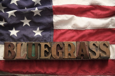 an American flag with the word bluegrass in old wood type Stok Fotoğraf