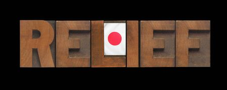 current events: the word relief in old wood type with a Japanese flag