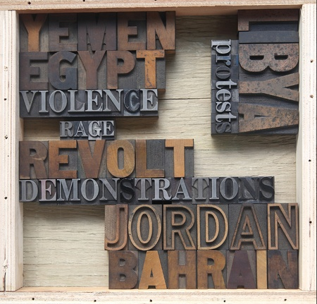 current events: words associated with uprisings in the Middle East in old wood type Stock Photo