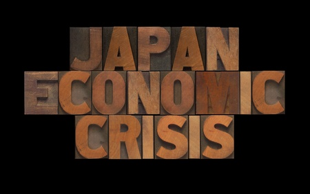 the words Japan economic crisis in old wood type photo