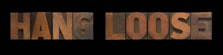 the words hang loose in old wood type