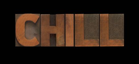 loosen up: the word chill in old wood type Stock Photo
