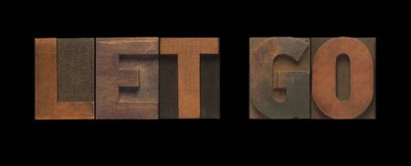 the words let go in old wood type Stock Photo - 10390776