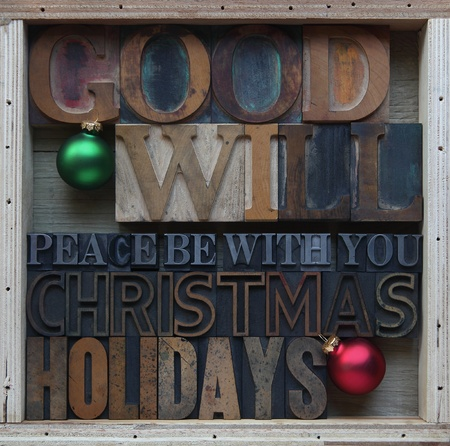 letterpress words: words associated with the Christmas holidays in letterpress type with ornaments