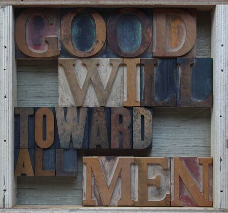 goodwill: words associated with the Christian holiday season in wood type