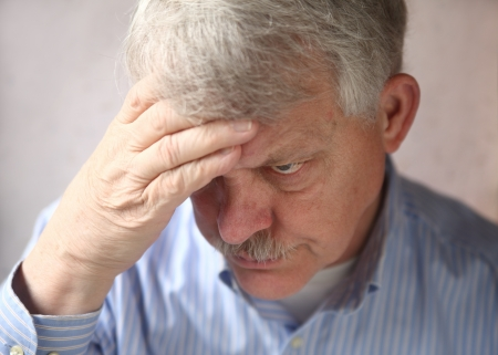 agitated: older man showing signs of annoyance, irritability and paranoia Stock Photo
