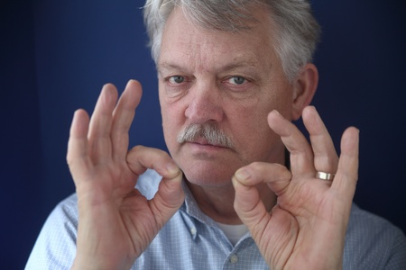 man gives positive hand gestures