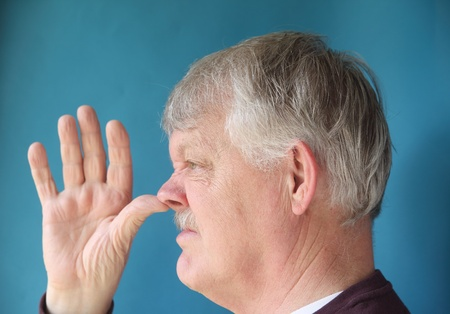 defiance: man makes gesture of contempt or defiance Stock Photo