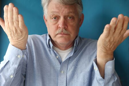 ignorance: businessman uses body language to convey giving up, ignorance, indifference or uncertainty Stock Photo