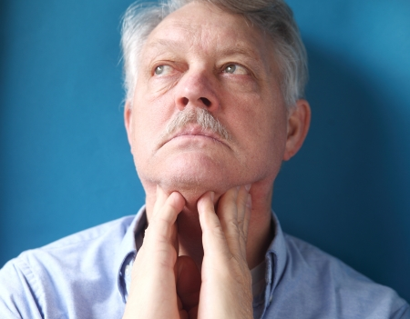 swelling: businessman checks for swelling in the lymph glands in his neck
