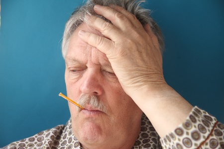 a senior man with a fever and aching head Stock Photo - 12609938