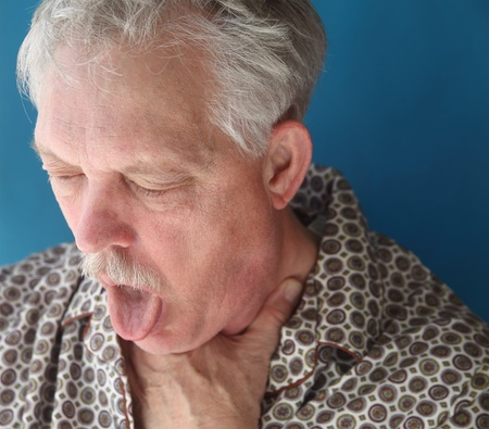distressed: an older man with a bad cough Stock Photo