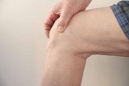 profile of a man s painful knee Stock Photo - 12609917