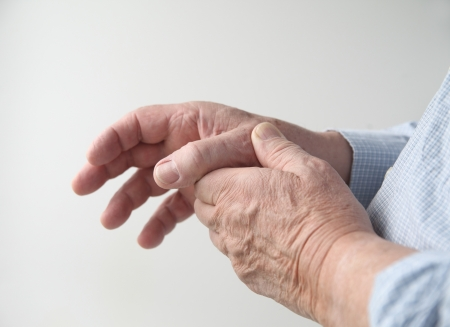 a man has pain in his thumb Stock Photo