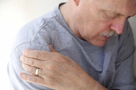 shoulder: man suffering from aching shoulder