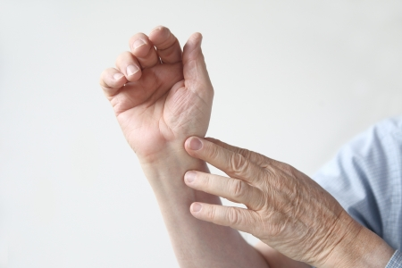 wrist pain: man indicates where the pain is located Stock Photo