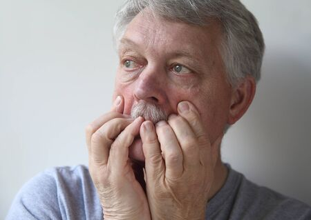 agitated: a senior with an anxious, fearful expression Stock Photo