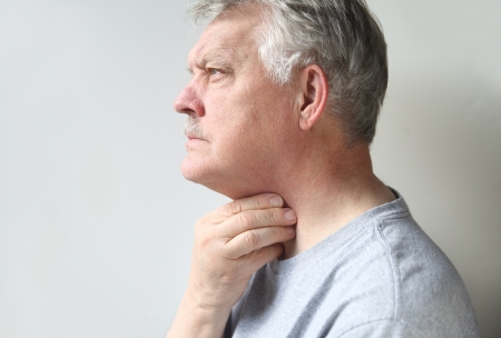 a senior is suffering from a sore throat photo