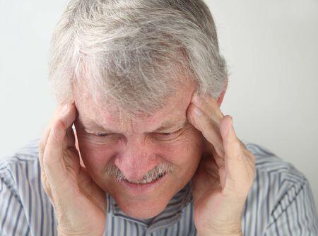 throbbing: an older man suffers from a very bad headache